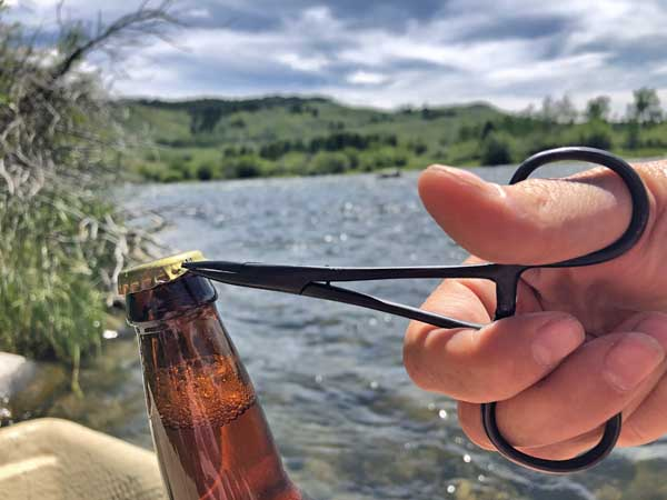 Opening a beer with forceps