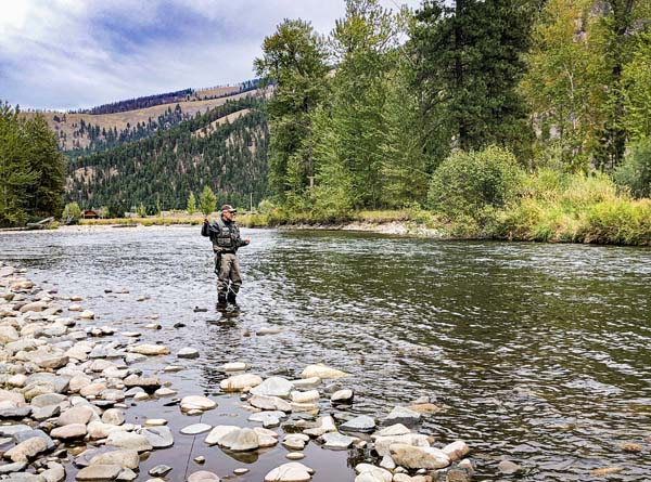 Dave Grilli hooking a fish on Rock Creek in September