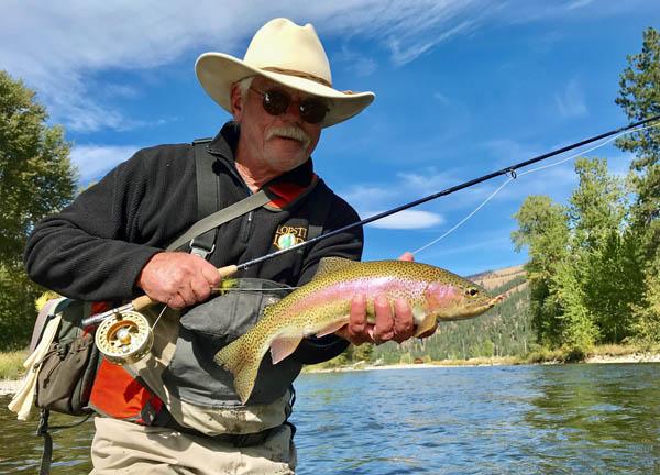Wayne Carini landing a rainbow trout in September on Rock Creek