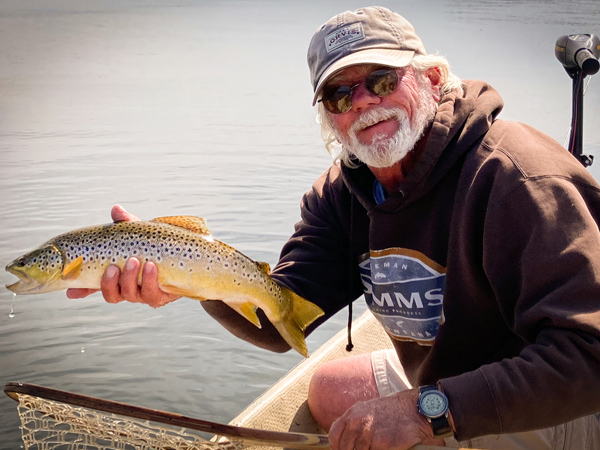 Tim with a Rainbow Trout caught during the callibaetis hatch on hebgen lake