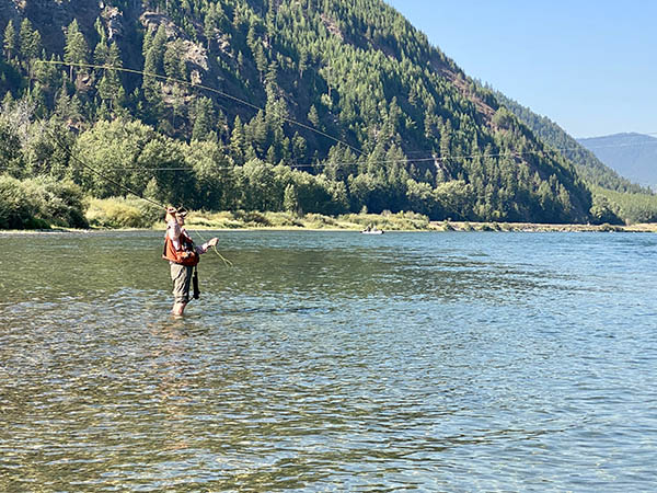 Yvonne casting to rising trout on the Kootenai River